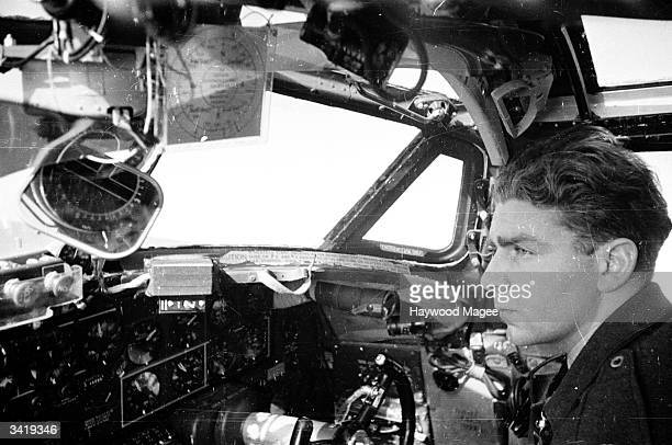 The copilot in the cockpit of a Liberator X 8816 the 2000th of its kind to land at Prestwick Airport Prestwick Airport receives many aircraft every...