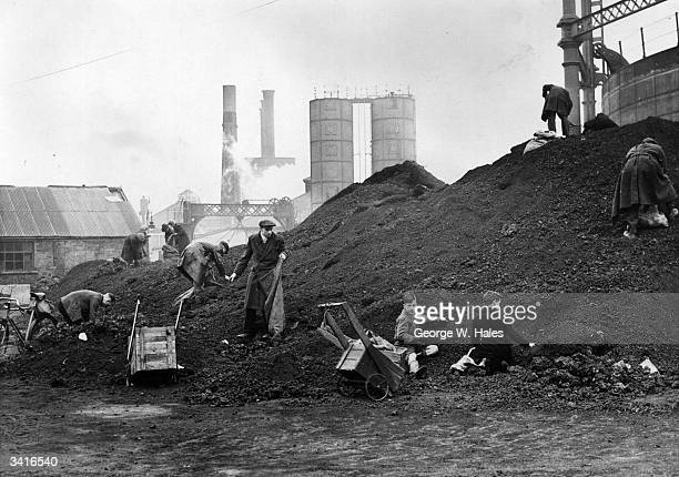 Searching coke heaps at the Gravesend Gasworks in Kent where diggers can take away 56 pounds of coke for a shilling