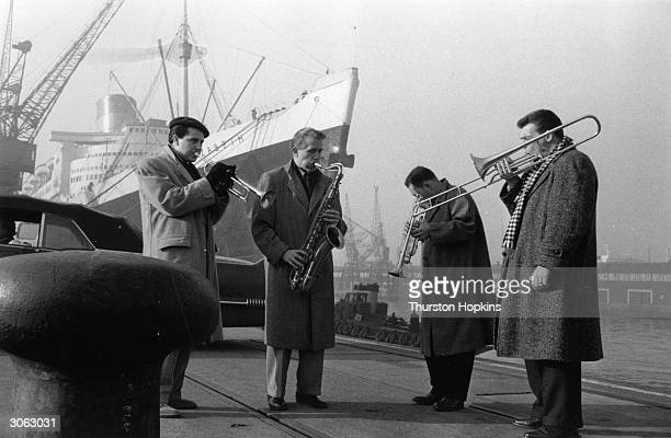 Members of Stan Kenton's jazz orchestra after their arrival from London Original Publication Picture Post 8312 The Big Noise pub 1956