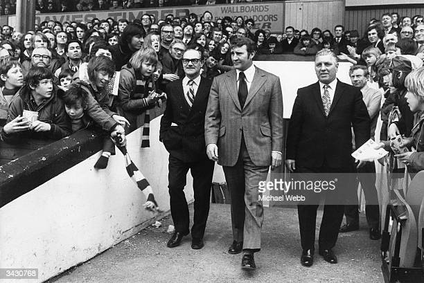 Former Manchester City manager Malcolm Allison meets the fans at Selhurst Park on his second day as manager of Crystal Palace Accompanying him on the...