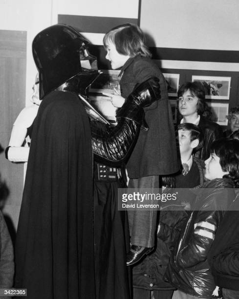 Stephen Henman from Bromley meeting Darth Vader during his visit to Selfridges in Oxford Steet to promote an exhibition of set models original...