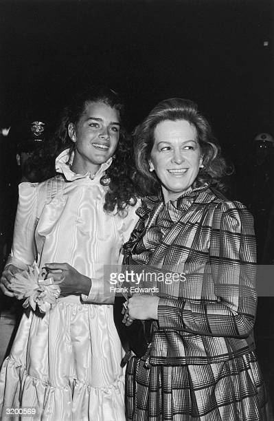 American model and actor Brooke Shields smiles while craning her neck beside to her mother, Teri Shields, at the Academy Awards, Dorothy Chandler...