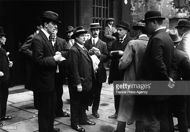 Journalists interviewing English tradeunion leader Ben Tillett as he arrives at a Board of Trade Conference during the Great Transport Strike which...