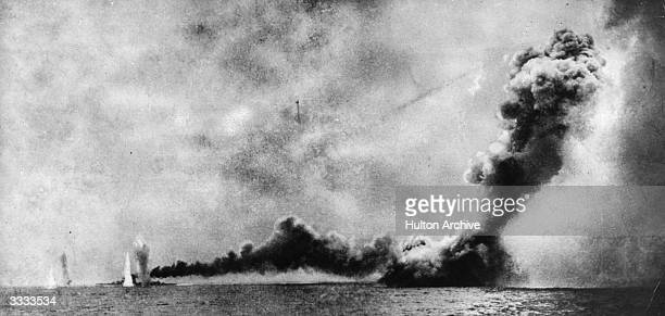 HMS 'Lion' left is shelled and HMS 'Queen Mary' right is blown up by German shells during the Battle of Jutland
