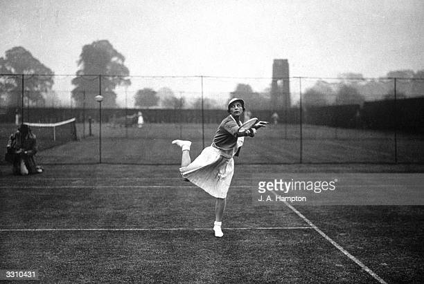 American tennis player Helen Wills Moody practising at Wimbledon before the start of the 1935 tournament