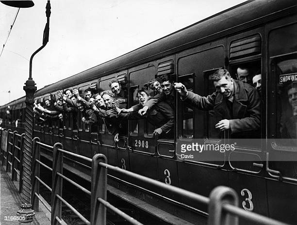 Train arrives in London loaded with happy British soldiers who have escaped from Dunkirk.