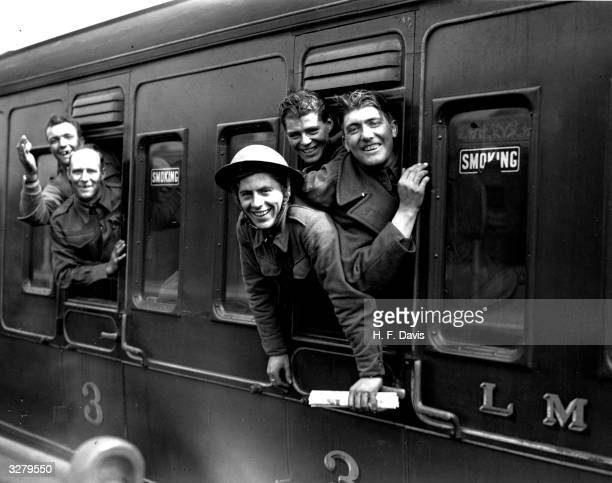 Members of the British forces arrive home by train after being evacuated from Dunkirk.
