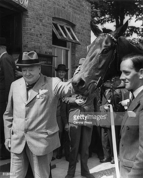 English conservative politician Sir Winston Churchill with his horse 'Canyon Kid' which won the Speed Stakes at Windsor