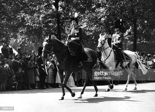 Queen Elizabeth II in front of Prince Philip Duke of Edinburgh en route to Horse Guards parade London for a Trooping of the Colour ceremony