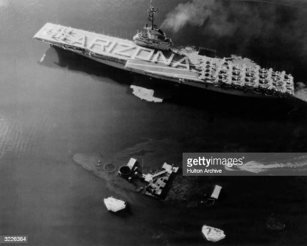 Aerial view of 1102 crew members of the USS 'Bennington' forming the word 'Arizona' on their ship deck in a mass salute to the 1102 members of the...