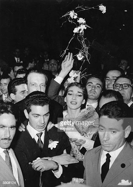 American born Greek soprano Maria Callas surrounded by admirers leaves La Scala Opera House Milan after her last performance there in the wake of a...