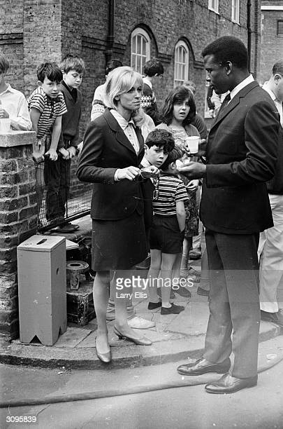 English actress Suzy Kendall with Sidney Poitier on the set of their new film 'To Sir With Love'