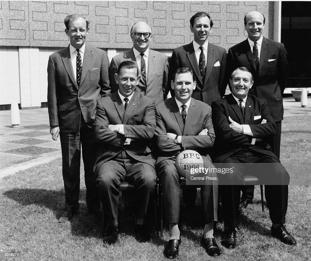 The BBC team who will provide coverage of the 1966 World Cup in England. Back row, from left to right: Frank Bough, Alan Weeks, David Coleman and Wally Barnes. Front row, from left to right: Ken Aston (referee), Kenneth Wolstenholme (1920 - 2002) and Arthur Ellis (referee).