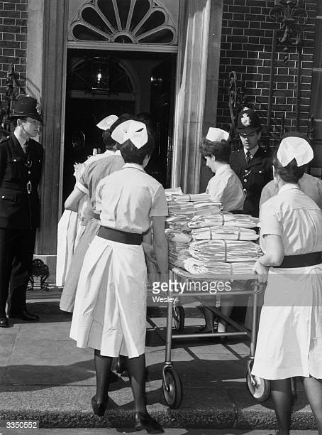 A group of six nurses deliver an anti abortion petition to 10 Downing Street