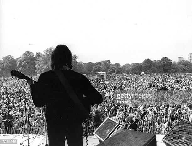 The lead guitarist of a group playing at the free pop concert held in Hyde Park London 1975
