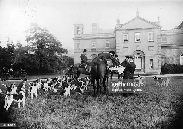 Riders from the Earl Fitzwilliam Hunt at Clumber take refreshments on the lawn
