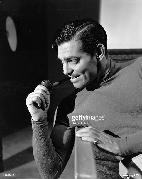 American actor Clark Gable smoking a pipe Known as the King of Hollywood he died two days after finishing filming on 'The Misfits'