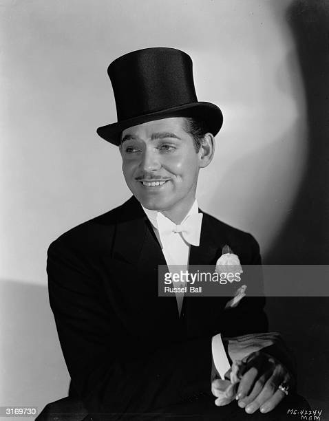 American actor Clark Gable wearing a top hat and dinner jacket