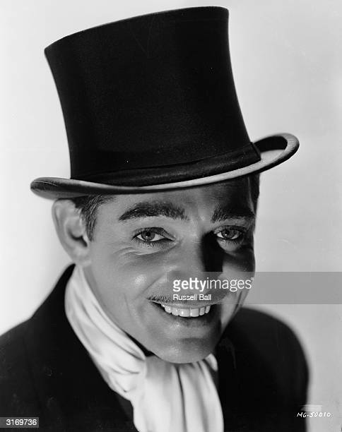 American actor Clark Gable wearing a top hat and white scarf. Nominated three times for the Academy Award for Best Actor, he won it only once, for...