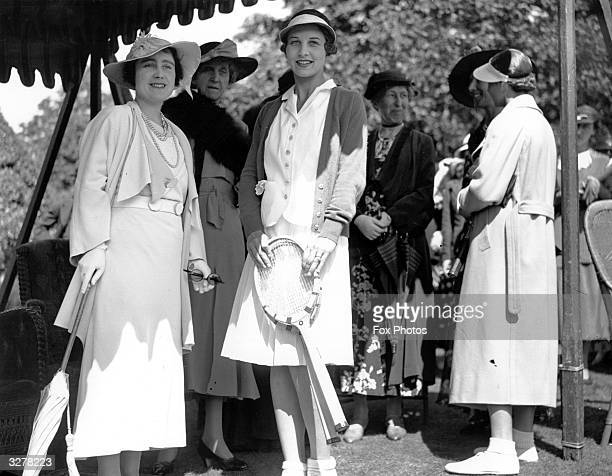 Queen Elizabeth Queen Consort to King George VI with American Wimbledon Champion Helen Wills Moody during a break at Wimbledon