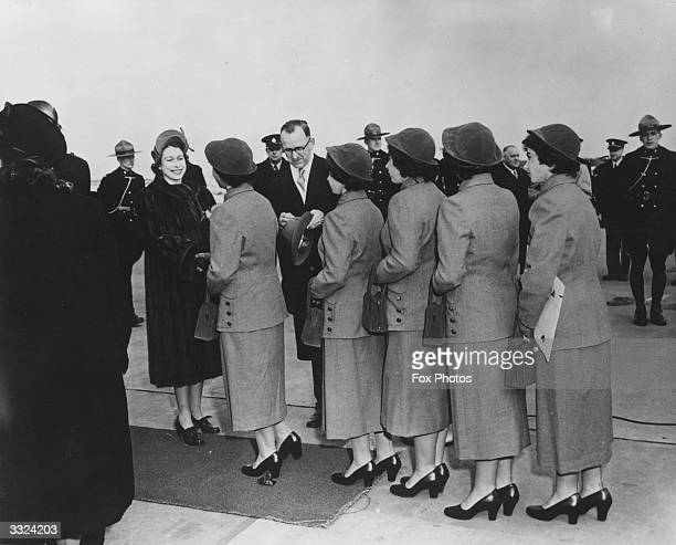 Queen Elizabeth II meets the Dionne quintuplets at North Bay during a tour of Canada