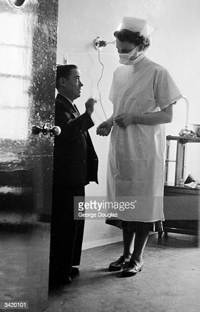 A nurse tells Jackie Hall 4 ft 2 ins tall that his wife Babs who is 3 ft 7 ins tall has given birth to a healthy fullsize baby weighing 6lb 8oz...