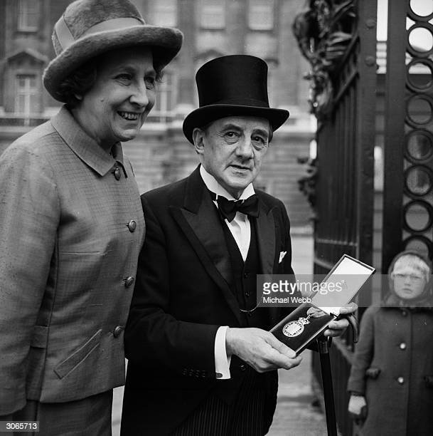 English born cellist and conductor John Barbirolli with his wife, the oboist Evelyn Rothwell after he had received his award as a Companion of Honour.