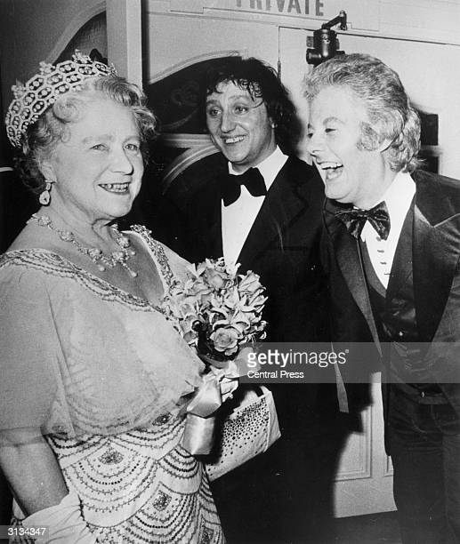 Elizabeth the Queen Mother swaps jokes with comedian Ken Dodd and female impersonator Danny La Rue after attending a Royal Variety Performance at the...