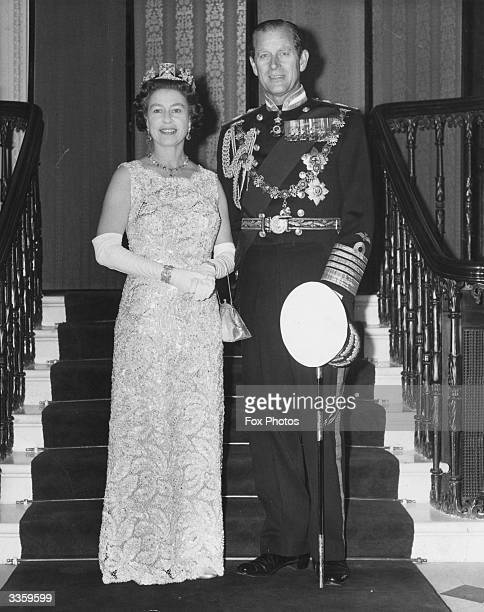 Queen Elizabeth II and Prince Philip Duke of Edinburgh inside Buckingham Palace after returning from the State Opening of Parliament