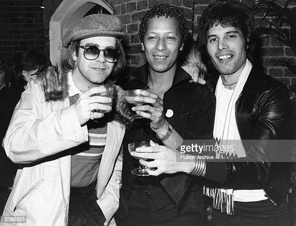Singer songwriter Elton John with star of musicals Peter Straker and Freddie Mercury singer with the group Queen