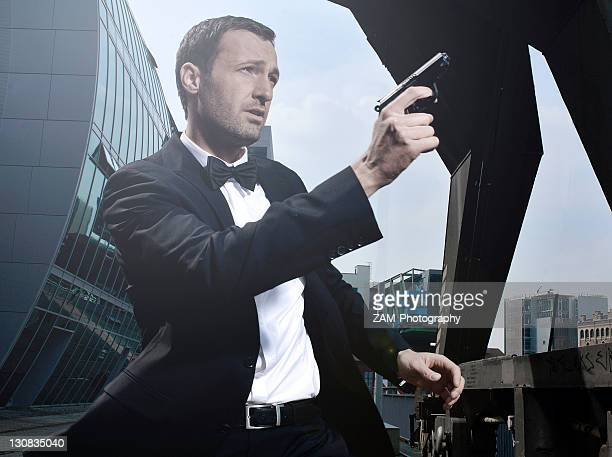 31-year-old man dressed up as james bond in duesseldorf harbour, north rhine-westphalia, germany, europe - スパイ ストックフォトと画像