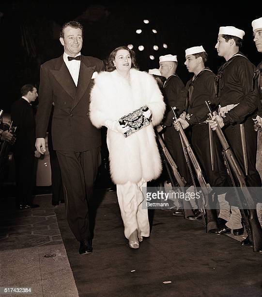3/20/1942Hollywood CA Star of Paramount's Reap The Wild Wind John Wayne is pictured with his wife Josephine on their arrival last night at the new...