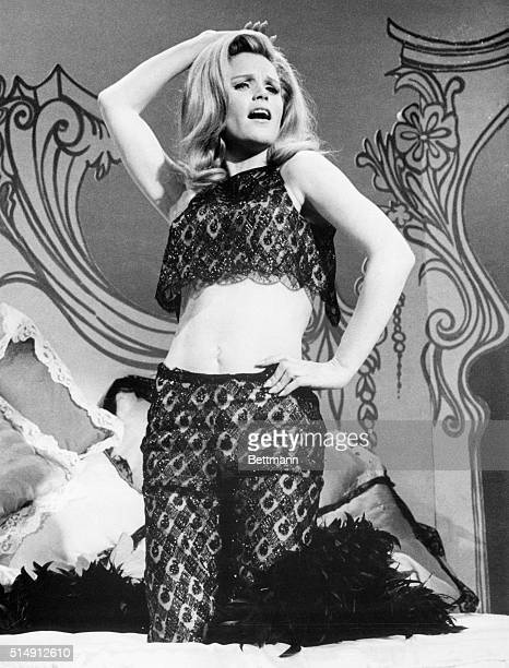 3/21/1967New York NY Look who has become a devilish beguiler It's Lee Remick who is stepping out of her usually demure roles to portray 'Lola' the...
