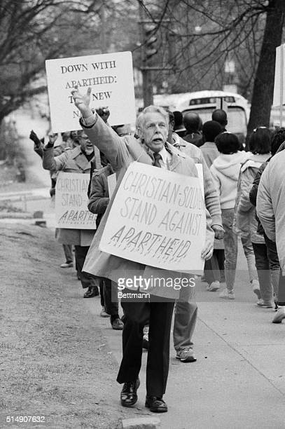 3/21/1985Washington DC A protester marches in front of the South African Embassy in DC on the 25th anniversary of the Sharpeville massacre