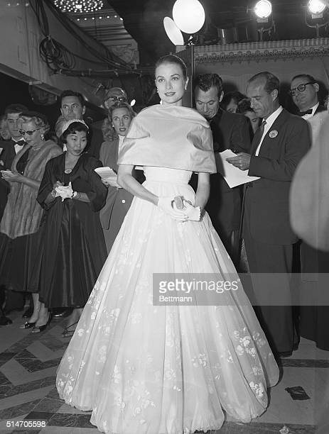 3/21/56Hollywood California Resplendent in a beautiful dress and escorted by a studio executive Grace Kelly makes her last public appearance in...