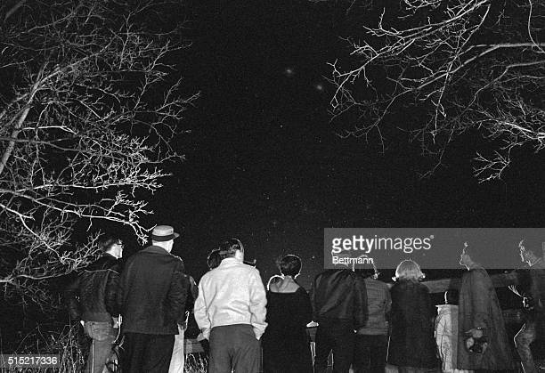 3/21/66DexterMichigan With unidentified flying objects reportedly frequenting the southern Michigan area curious citizens are turning out by the...