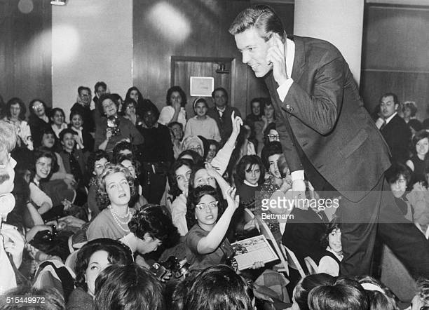 3/2/1963New York New York Richard Chamberlain star of the TV series 'Dr Kildare' leans forward to hear a question from one of his admirers as he...