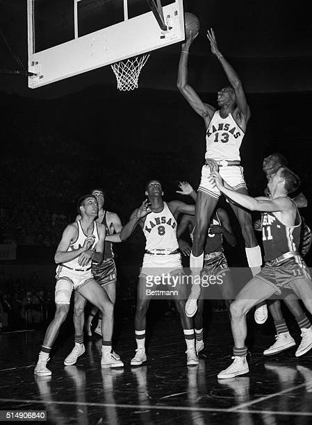 3/22/1957Kansas City MO Up up goes giant Wilt The Stilt Chamberlain of Kansas to score easily over heads of San Francisco Dons during semifinal game...