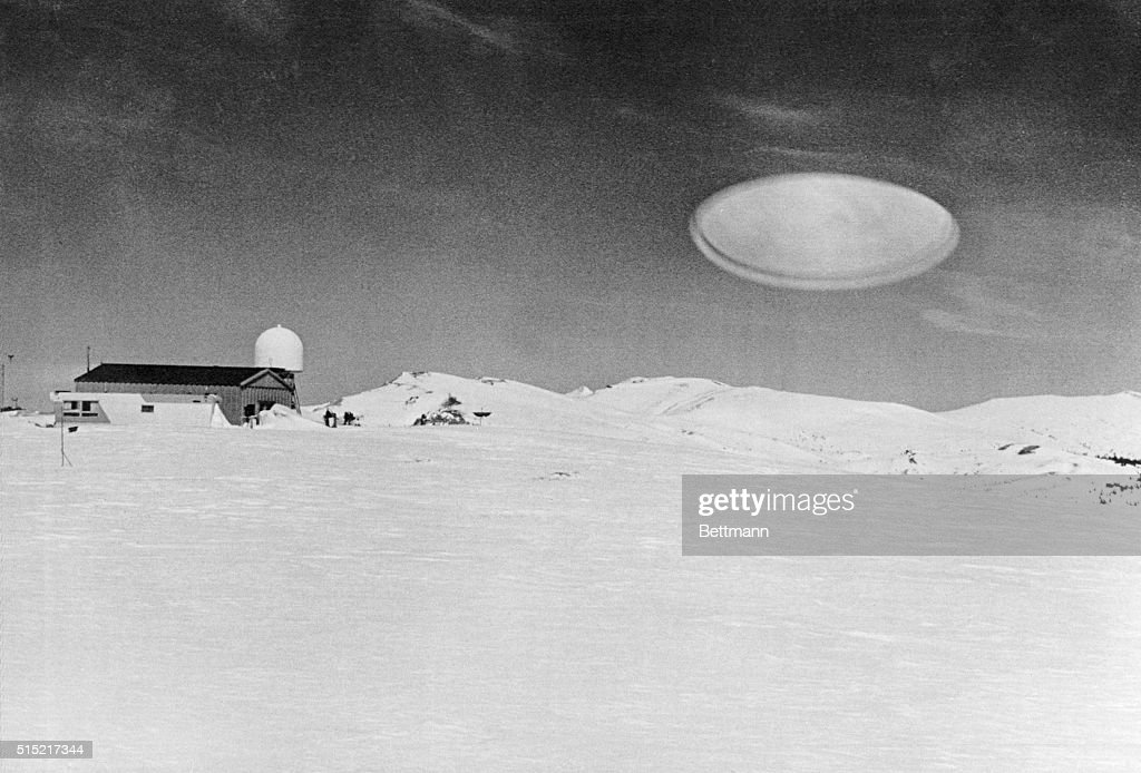 Ufo Over Barn In Snow Covered Field : News Photo
