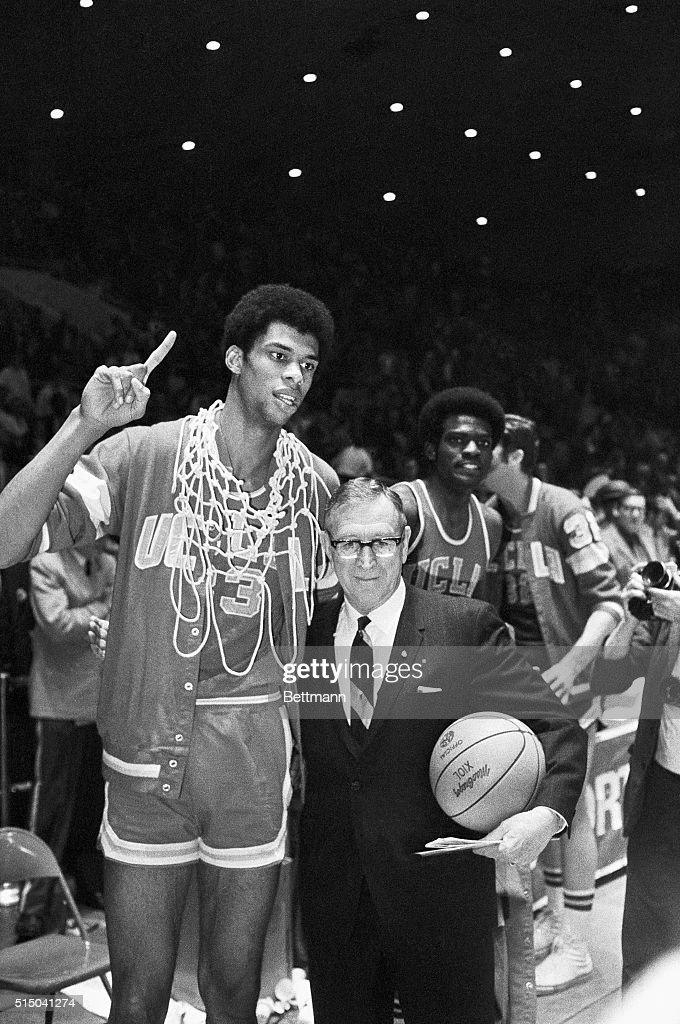 Louisville, KY- NCAA Finals. Lew Alcindor of UCLA, who played his last game of college basketball, holds up hand signifying that they are the number one team in the country. John Wooden, UCLA coach, is pictured along side the All American, who scored 37 points to defeat Purdue, 92-72, capturing the third straight championsip game.