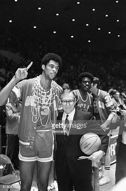 3/22/1969Louisville KY NCAA Finals Lew Alcindor of UCLA who played his last game of college basketball holds up hand signifying that they are the...