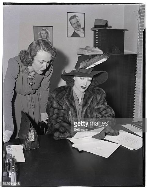 3/22/39Hollywood California Film actress Joan Crawford shown with Olive Howard at whose notary office she called to answer deposition questions about...