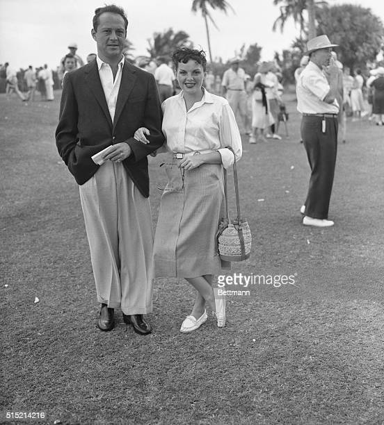 3/23/1952West Palm Beach FL Screen star Judy Garland and her fiance Sidney Luft pause in the sun at the Seminole Golf Club Miss Garland is...