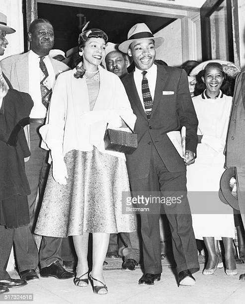 3/23/1956Montgomery AL Reverend Martin Luther King Jr is shown with his wife as they emerge from court house following the conclusion of his trial on...