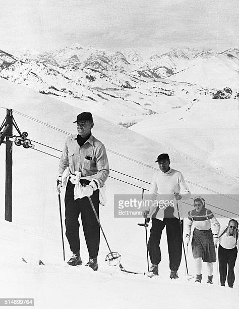Sun Valley, Idaho: Clark Gable and Mr. And Mrs. Gary Cooper going up the slopes.