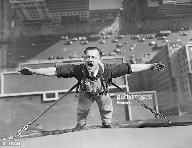 AhhhhAir like wineAn unusual picture of one of the intrepid window washers working on the Empire State Buildingas he pauses in his task to draw a...