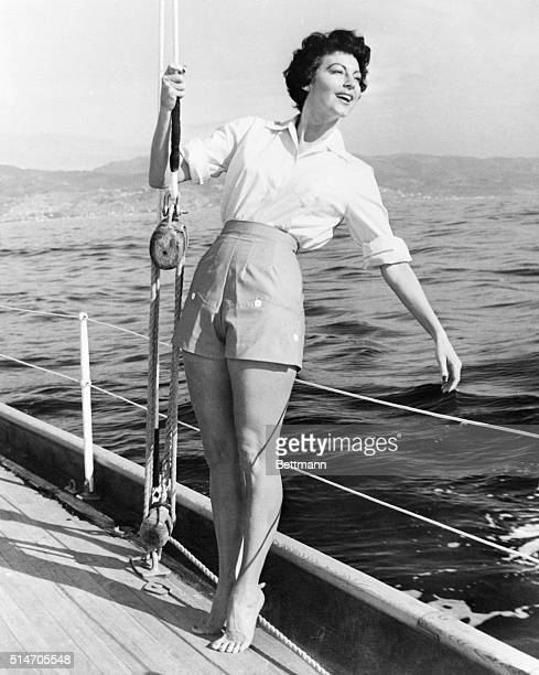 3/24/1954San Remo Italy Hanging onto the boat's rigging actress Ava Gardner enjoys a breezy outing in the Riviera sunshine Glamourous Ava is in Italy...