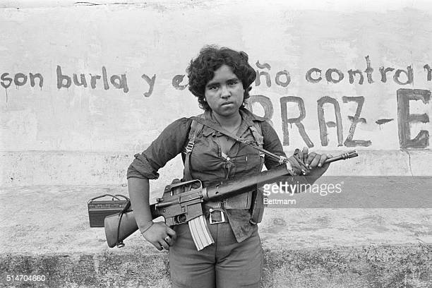 San Jorge, El Salvador: A guerrilla woman stands guard at a roadblock on the outskirts of San Jorge 3/23 as her comrades spread anti-election...