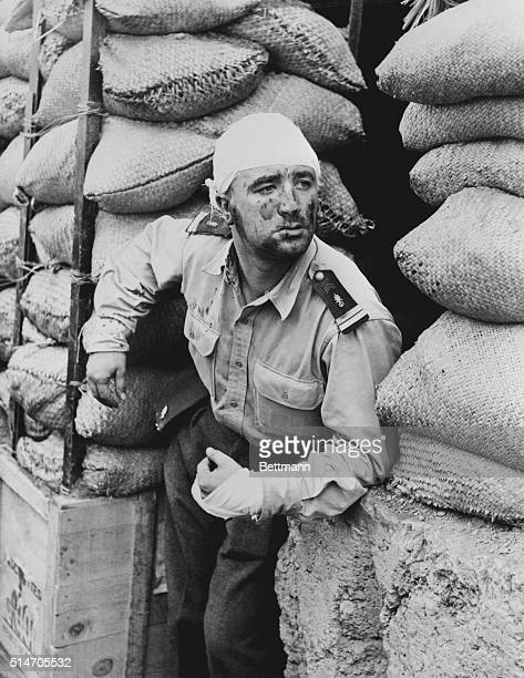 Dien Bien Phu, Korea: Foreign Legion lieutenant standing between stacks of goods.