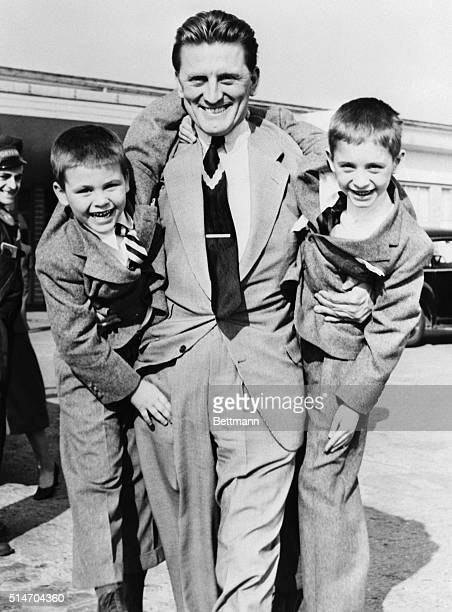 3/25/1953Paris France Obviously happy to see his two sons is film actor Kirk Douglas who gives the boys a hearty welcome at Orly Airport after their...